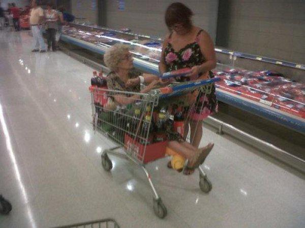 b856d157d210af939584cd1b7d8aa0be-old-lady-sitting-in-shopping-cart
