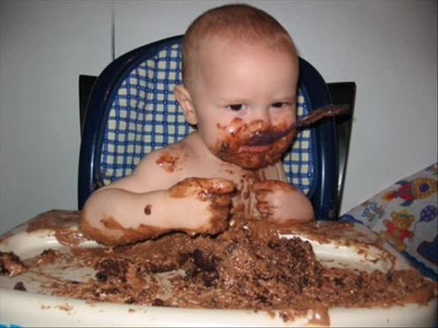 Baby-Eating-Cake-And-Making-Funny-Face